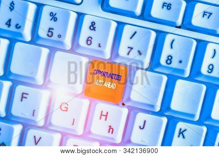 Text sign showing Opportunities Just Ahead. Conceptual photo Advantageous circumstances Perseverance pays off White pc keyboard with empty note paper above white background key copy space. stock photo