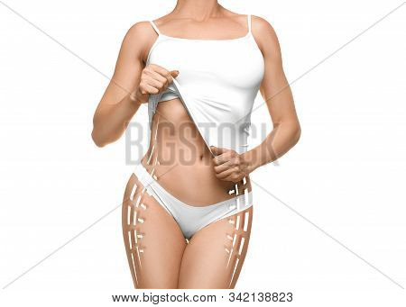 Perfect female body with slimming linew and arrows over white background. Slimming, dieting and health care concept. stock photo