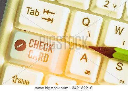 Conceptual hand writing showing Check Card. Business photo showcasing allows an account holder to access funds in her account. stock photo