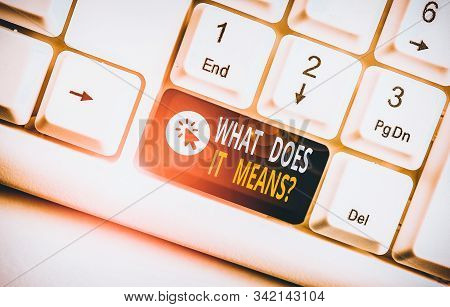 Word writing text What Does It Means question. Business concept for asking someone about meaning you do not understand White pc keyboard with empty note paper above white background key copy space. stock photo