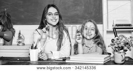 Express your creativity with drawing. Happy teacher and small child hold drawing pens. Little girl and cute woman use markers for drawing. Drawing lessons and crafts for kids stock photo