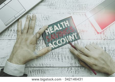 Writing note showing Health Savings Account. Business photo showcasing users with High Deductible Health Insurance Policy. stock photo