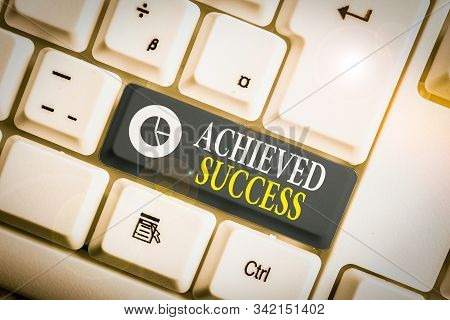 Word writing text Achieved Success. Business concept for the achievement of desired visions and planned goals White pc keyboard with empty note paper above white background key copy space. stock photo