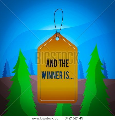 Word writing text And The Winner Is. Business concept for announcing a demonstrating or thing that wins something Empty tag blank space colorful background label rectangle attached string. stock photo