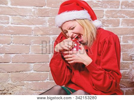 Wish list. Definitely like it. All i want for christmas. Woman excited opening gift from santa claus. Christmas eve excitement. Open christmas box. Girl emotional excited face hold christmas gift stock photo