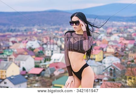 Girl attractive sexy body posing landscape background. Woman wear sunglasses and bikini. Sporty female sexy body. Sexy fashionable lady. Swimsuit fashion. Fashion trend. Her confidence is stunning stock photo