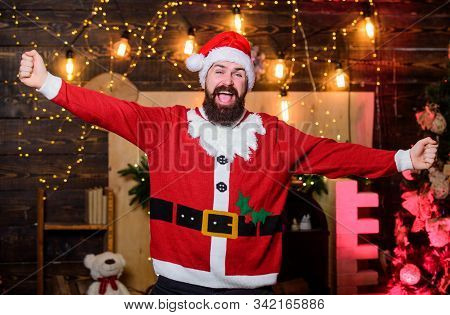 Santa claus costume. New year celebration. Tradition celebration. Celebrate winter holidays. Indulge yourself in joy. Celebration time. Man bearded santa celebrate christmas at home. Winter carnival stock photo