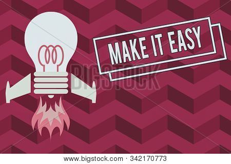 Word writing text Make It Easy. Business concept for Smart approach Effortless Free from worries or difficulties Top view launching bulb rocket fire base. Starting new project. Fuel idea. stock photo