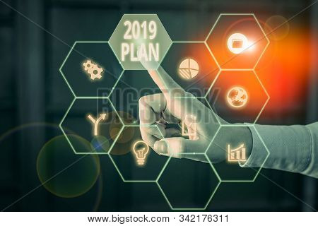 Word writing text 2019 Plan. Business concept for setting up your goals and plans for the current year or in 2019 Picture photo system network scheme modern technology smart device. stock photo
