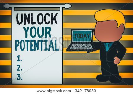 Word writing text Unlock Your Potential. Business concept for improve self awareness Skills to Achieve more Standing professional businessman holding open laptop right hand side. stock photo