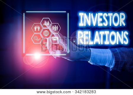 Writing note showing Investor Relations. Business photo showcasing analysisagement responsibility that integrates finance Picture photo network scheme with modern smart device. stock photo
