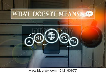 Handwriting text What Does It Means Question. Concept meaning asking meaning something said and do not understand Picture photo system network scheme modern technology smart device. stock photo