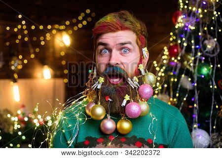 Happy new year. Surprised Santa man with decorated beard. New year party. Bearded Santa man with decorated beard. Merry Christmas. Decorated beard. Christmas decorations. Christmas beard decorations stock photo