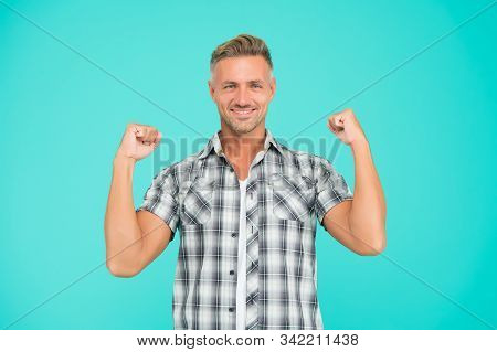 Casual and powerful. Strong guy flex arms blue background. Handsome man in casual style. Casual fashion trends. Fashion and style. Feeling comfortable. Casual look. stock photo