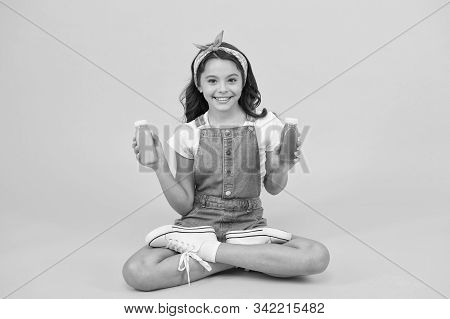 Healthy way of life. Vegetarian smoothie drink. Yoga training. KId girl sit meditate. Meditating practice. Good vibes. Peaceful meditating. Learn meditating techniques. Stay positive and optimistic. stock photo