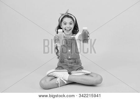 Vegetarian smoothie drink. Learn meditating techniques. Stay positive and optimistic. Healthy way of life. Yoga training. KId girl sit meditate. Meditating practice. Good vibes. Peaceful meditating. stock photo