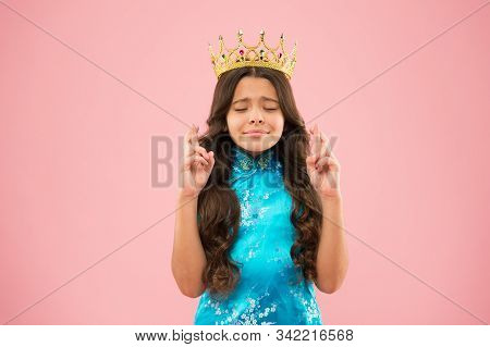 Hope. Winner of beauty competition. International beauty contest. Kid wear golden crown symbol of princess. Become princess. Little princess. Girl wear crown. Princess manners. Award concept. stock photo