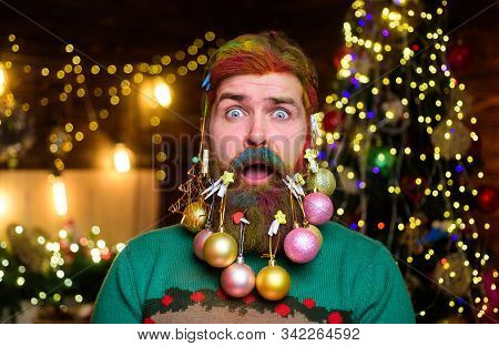 Decorated beard. New year party. Surprised Santa man with decorated beard. Bearded Santa man with decorated beard. Merry Christmas. Happy new year. Christmas beard decorations. Christmas decorations stock photo
