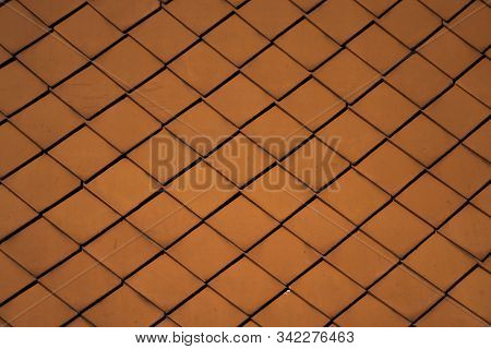 Natural orange roof tiles on a building as a texture. stock photo