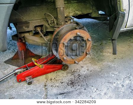 Rusty Front Car Wheel Hub with Disk Brake System. As Car Maintenance concept. Disc brakes. Brake Disk And Detail Of The Wheel Hub. Replacing the wheel on the car. stock photo