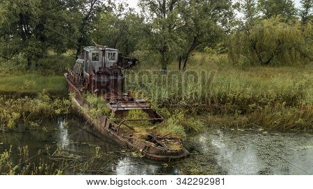 Aerial view abandoned ships in the river near of Chernobyl. The abandoned river port in Pripyat. Modern ruins. Radioactive metal. stock photo