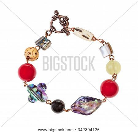 top view of hand crafted bracelet from iridescent nacre, bone and agate beads isolated on white background stock photo