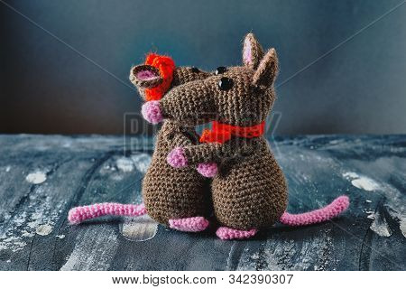 Handmade amigurumi rats couple hug each other. Blue background. Valentine day, February 14, love, relations concept stock photo