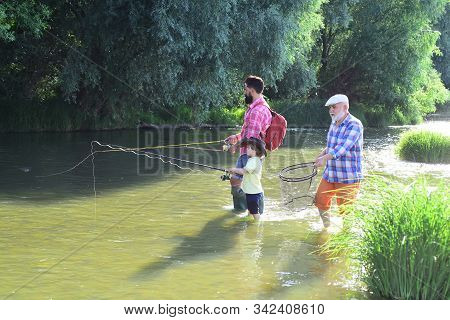 Happy people family have fishing and fun together. Men hobby. Man in different ages. Outdoors active lifestyle. Father and son fishing stock photo