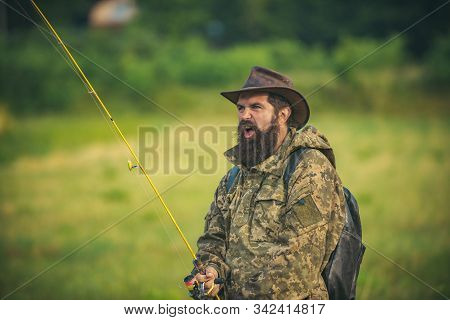 Portrait of cheerful senior man fishing. Guy fly fishing. Catching and fishing. Male hobby. Rural getaway. Mature man fly fishing. Weekend. Man catching fish. Active day. Trout bait stock photo