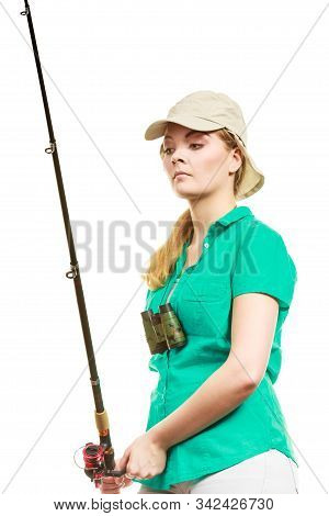 Fishery, spinning equipment, angling sport and activity concept. Woman with fishing rod. stock photo