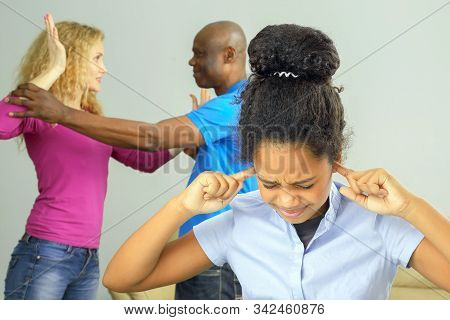 the parents in the family conflict out of the relationship with the teenage daughter. problems in family relationships and negative emotions stock photo
