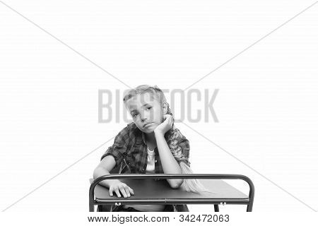 Need some rest and entertainment. Boring lesson. Girl bored pupil sit at desk. Issues of formal education. Back to school concept. Kid cute tired of boring studying. Boring educational program. stock photo
