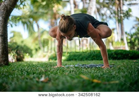 Man practice Yoga practice and meditation outdoor. stock photo