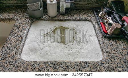 Overflowing kitchen sink, clogged drain, blocked drain. stock photo