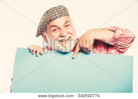 happy mature man in retro hat. Advertisement. Senior bearded man place announcement on banner. job search. Need help. wanted. Copy space placate information. presenter of your advertisement stock photo