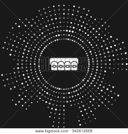 White Teeth with braces icon isolated on grey background. Alignment of bite of teeth, dental row with with braces. Dental concept. Abstract circle random dots. Vector Illustration stock photo