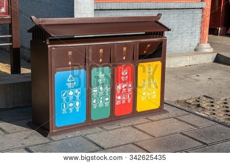 Different colored bins for collection for waste separation in China for next generation. China containers for separate waste collection. stock photo