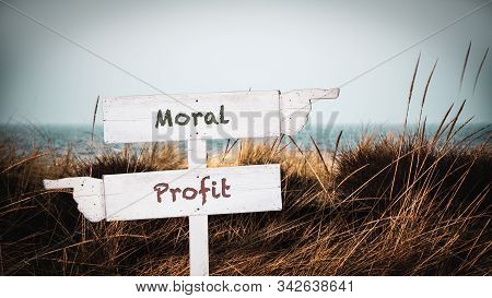 Street Sign the Direction Way to Moral versus Profit stock photo
