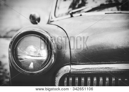 vintage cars abandoned and rusting away black and white photo stock photo