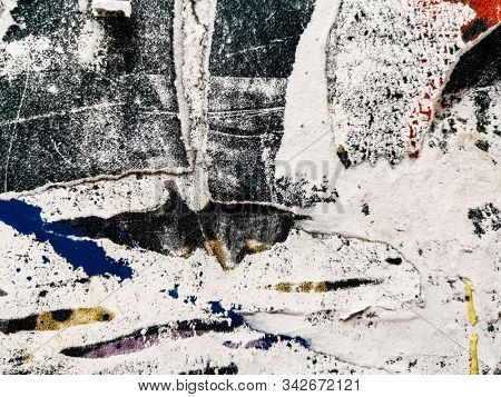 Old grunge ripped torn vintage posters creased crumpled paper surface texture background stock photo