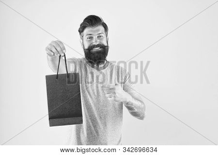 try this. Man with purchase. Buy product. bearded man go shopping. Shop store mall boutique. mature male cheerful with fashion purchase. small present. Happy hipster hold paper bag. copy space. stock photo