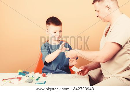 medicine and health. happy child with father with stethoscope. small boy with dad in hospital. father and son in uniform. family doctor. trust and values. cool father play with kid. father doctor stock photo