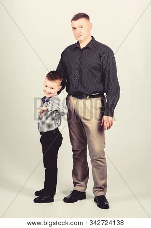 child with father. business partner. little boy with dad businessman. childhood. parenting. fathers day. family day. father son in business suit. business partner concept. family business partner stock photo