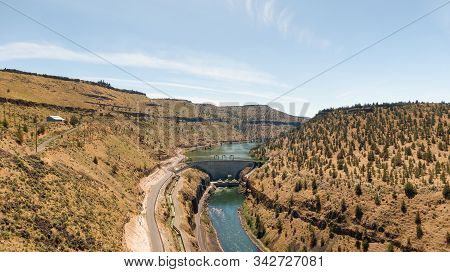 Panoramic Aerial View of a Dam during a sunny summer day. Madras, Oregon, United States of America. stock photo