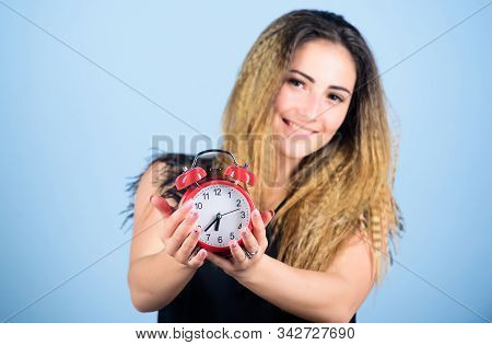 Counting time till deadline. Overwork or being late. It is time. Watch repair. Few minutes. Time management. Punctuality and discipline. Pretty girl managing her time. Woman hold red alarm clock stock photo