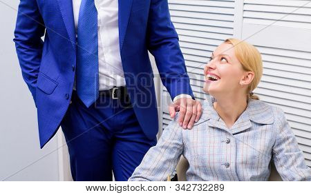 couple in love. partnership. love affair at work. Banned relations at work. Sexual harassment workplace. Woman office secretary in love with boss. Boss man unacceptable behavior subordinate employee stock photo
