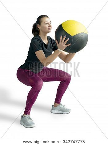 Beautiful sporty woman doing squats with med ball. Photo of muscular fitness model isolated on white background. Fitness and healthy lifestyle concept stock photo