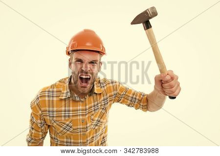 Angry boss. Destroy and build. Repair service. Repair and renovation concept. Handyman home repair. Repairing and renovating. Home improvement. Man in helmet aggressive laborer. Repair workshop. stock photo