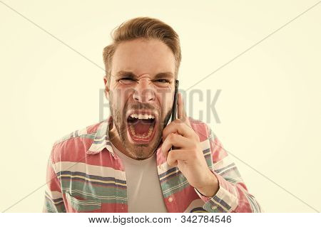 Bully manners. Ignorant man shouting mobile conversation close up. Guy screaming while having mobile call. Rules of mobile communication. Bad connection. Listen to me. Angry aggressive speaker. stock photo