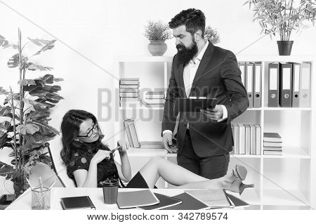 Hire replacements for vocational staff. Temporary employee. Businessman and female employee. Sexy administrative employee and employer. Adorable woman employee and bearded man. Employing personnel. stock photo